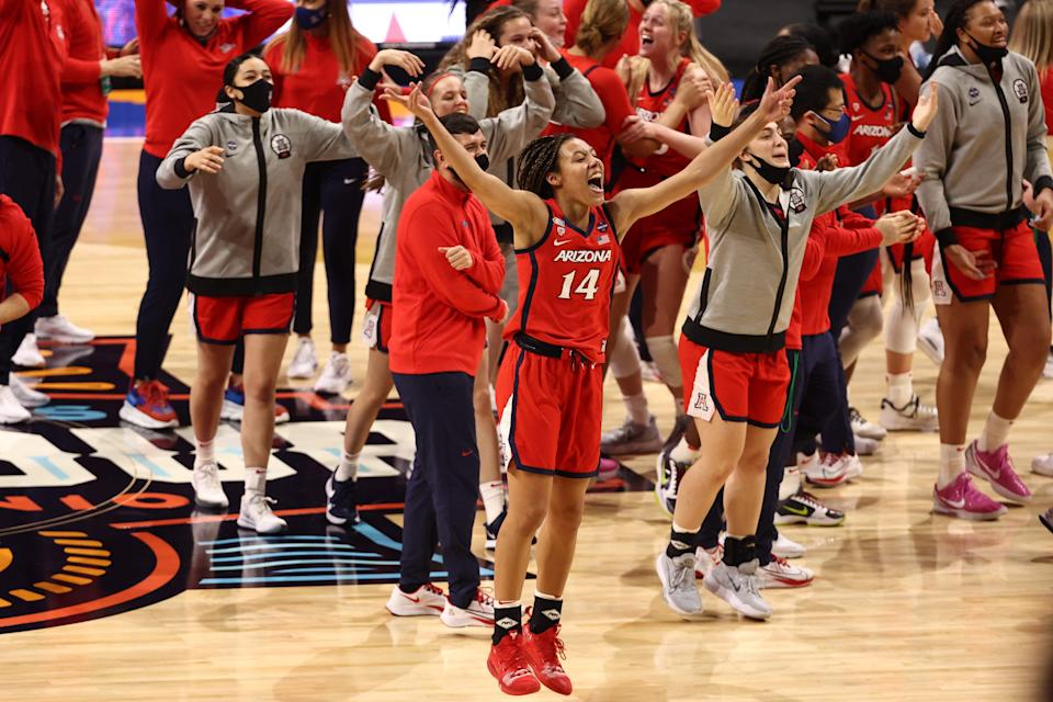 Arizona forward Sam Thomas and teammates celebrate after defeating the UConn Huskies in the women's Final Four. The Wildcats face the Stanford Cardinal in the national championship game.