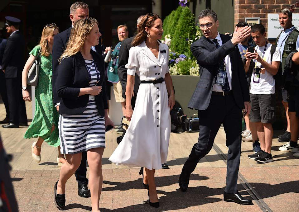 Britain's Catherine, Duchess of Cambridge arrives at Court 14 to watch Britain's Harriet Dart playing against US player Christina McHale at The All England Tennis Club in Wimbledon, southwest London, on July 2, 2019, on the second day of the 2019 Wimbledon Championships tennis tournament. (Photo by Glyn KIRK / AFP) / RESTRICTED TO EDITORIAL USE        (Photo credit should read GLYN KIRK/AFP/Getty Images)