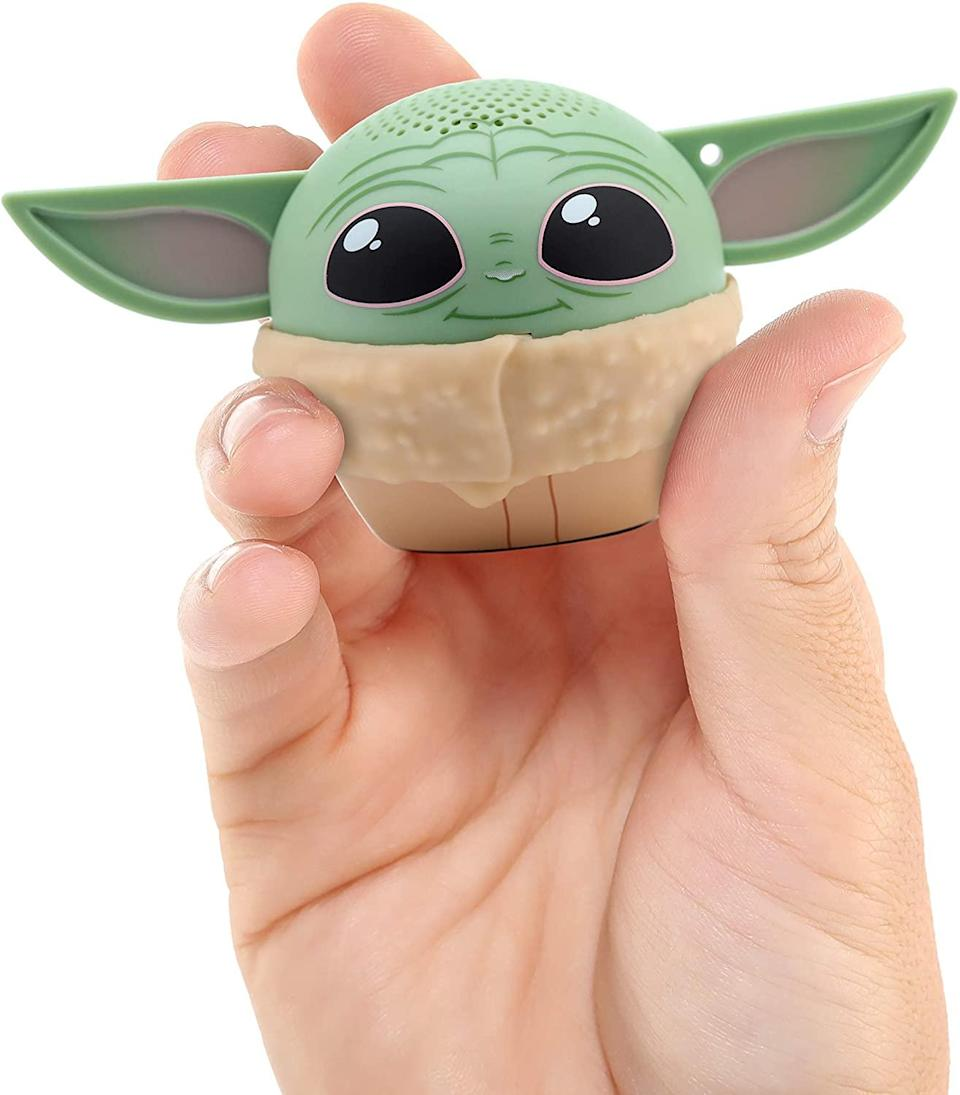 """<h2>Bitty Boomers Star Wars: The Mandalorian The Child Bluetooth Speaker</h2><br>This little Bluetooth-compatible speaker is shaped like everyone's favorite character from <em>The Mandalorian</em> — and now that we've seen it, no tech accessory will ever be as cute. <br><br><strong>Bitty Boomers</strong> Star Wars: The Mandalorian The Child Bluetooth Speaker, $, available at <a href=""""https://amzn.to/3qnsipJ"""" rel=""""nofollow noopener"""" target=""""_blank"""" data-ylk=""""slk:Amazon"""" class=""""link rapid-noclick-resp"""">Amazon</a>"""