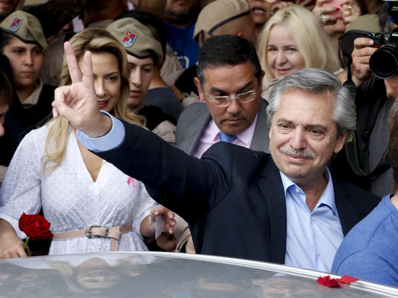 """Alberto Fernandez, presidential candidates for the """"Frente para Todos"""" coalition, arrives to vote in Buenos Aires, Argentina, Sunday, Oct. 27, 2019. Argentina could take a political turn in Sunday's presidential elections, with center-left Peronist candidate Fernandez favored to oust conservative incumbent Mauricio Macri amid growing frustration over the country's economic crisis. (AP Photo/Natacha Pisarenko)"""