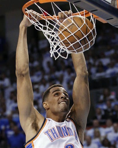 Oklahoma City Thunder guard Thabo Sefolosha dunks against the San Antonio Spurs during the first half of Game 4 in the NBA basketball playoffs Western Conference finals, Saturday, June 2, 2012, in Oklahoma City. (AP Photo/Sue Ogrocki)