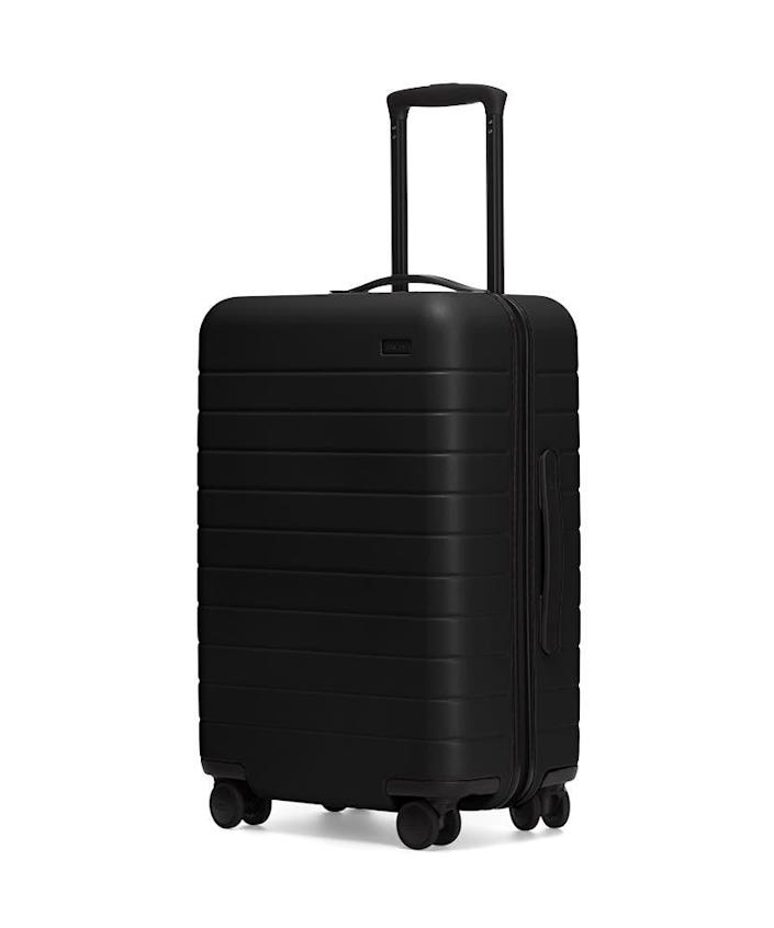 """If he's planning a big trip, this sturdy Away luggage is a perfect travel companion—it's built to handle rough journeys and has a handy removable phone charger too. $245, Away. <a href=""""https://www.awaytravel.com/suitcases/bigger-carry-on/black"""" rel=""""nofollow noopener"""" target=""""_blank"""" data-ylk=""""slk:Get it now!"""" class=""""link rapid-noclick-resp"""">Get it now!</a>"""