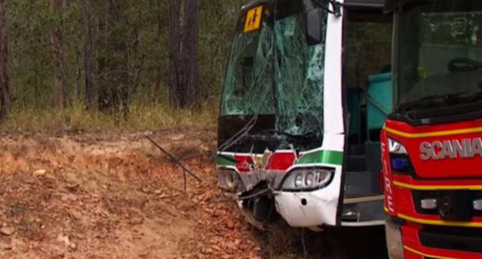 A school bus with a shattered window from a collision with a 4WD.