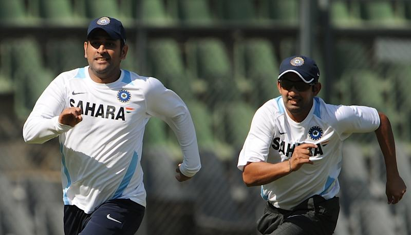 Indian cricket team captain Mahendra Singh Dhoni (L) and Gautam Gambhir run during a practice session at the Wankhede stadium in Mumbai on November 20, 2011. India are looking to keep the pressure on the beleaguered West Indies in the third and final Test of their series starting in Mumbai on November 22 as they seek to seal a 3-0 series whitewash. AFP PHOTO/Punit PARANJPE (Photo credit should read PUNIT PARANJPE/AFP via Getty Images)