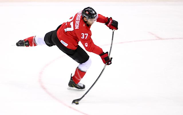 SOCHI, RUSSIA - FEBRUARY 23: Patrice Bergeron #37 of Canada controls the puck during the Men's Ice Hockey Gold Medal match against Sweden on Day 16 of the 2014 Sochi Winter Olympics at Bolshoy Ice Dome on February 23, 2014 in Sochi, Russia. (Photo by Streeter Lecka/Getty Images)