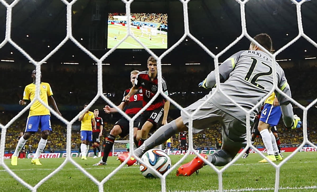 Germany's Andre Schuerrle (9) scores their sixth goal during their 2014 World Cup semi-finals against Brazil at the Mineirao stadium in Belo Horizonte July 8, 2014. REUTERS/Kai Pfaffenbach (BRAZIL - Tags: SOCCER SPORT WORLD CUP)
