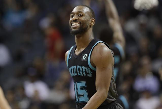Charlotte Hornets' Kemba Walker seems willing to accept less money if the Charlotte Hornets build around him. (AP Photo/Chuck Burton)
