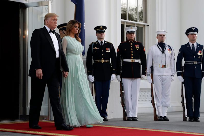 President Donald Trump and first lady Melania Trump walk to welcome Australian Prime Minister Scott Morrison and his wife Jenny Morrison to a state dinner at the White House, Sept. 20, 2019.