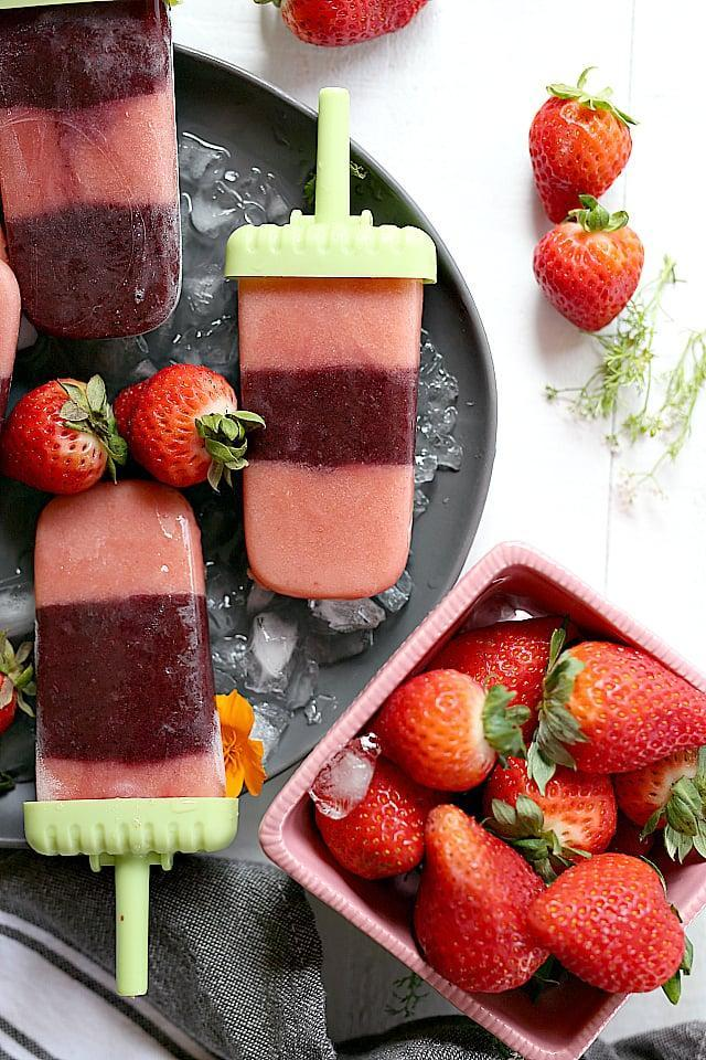 """<p>If you can hide veggies in smoothies, why not popsicles, too? The veggies in these strawberry-based treats add nutrients, but you'll never even notice they're there.</p> <p><strong>Get the recipe:</strong> <a href=""""https://delightfulmomfood.com/strawberry-popsicles-homemade-fruit-veggies-vegan/"""" class=""""link rapid-noclick-resp"""" rel=""""nofollow noopener"""" target=""""_blank"""" data-ylk=""""slk:strawberry popsicle with kale and squash"""">strawberry popsicle with kale and squash</a></p>"""