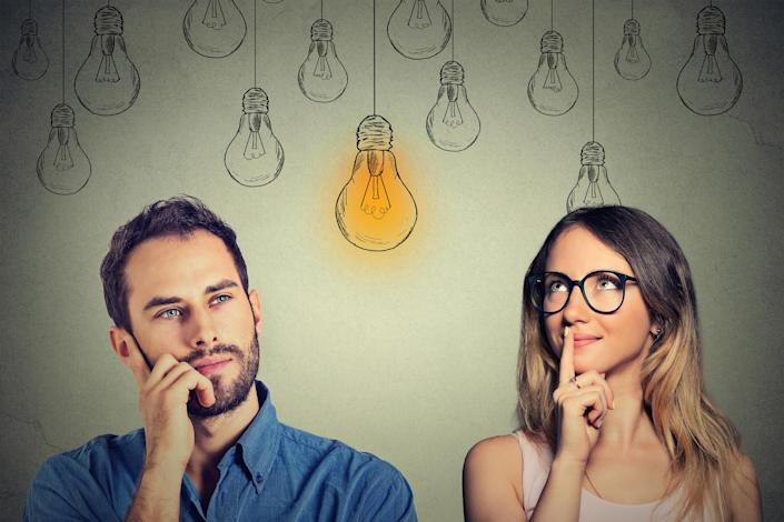 Man and woman with drawings of light bulbs behind them