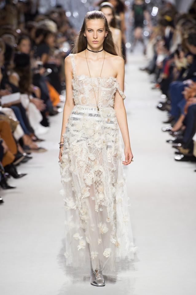 <p><i>White sheer lace dress from the SS18 Dior collection. (Photo: ImaxTree) </i></p>