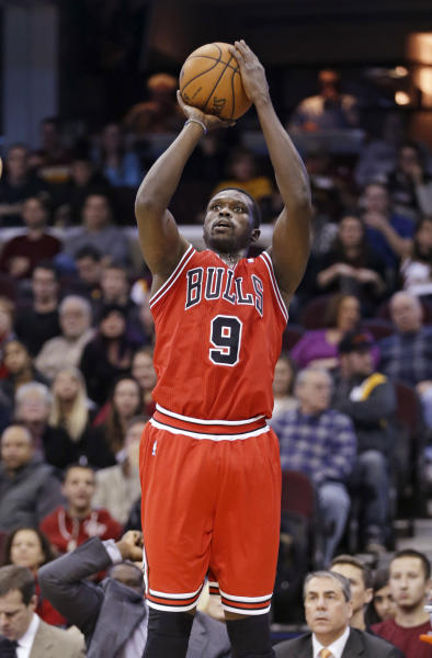 In this Nov. 30, 2013 photo, Chicago Bulls' Luol Deng, from Sudan, shoots against the Cleveland Cavaliers in an NBA basketball game in Cleveland. The Cavaliers acquired Deng, a two-time All-Star small forward, from the Chicago Bulls early Tuesday, Jan. 7, 2014, for center Andrew Bynum and future draft choices. (AP Photo/Mark Duncan)
