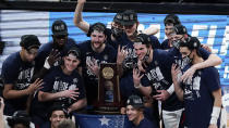 Gonzaga players celebrate after an Elite 8 game against Southern California in the NCAA men's college basketball tournament at Lucas Oil Stadium, Tuesday, March 30, 2021, in Indianapolis. Gonzaga won 85-66. (AP Photo/Michael Conroy)