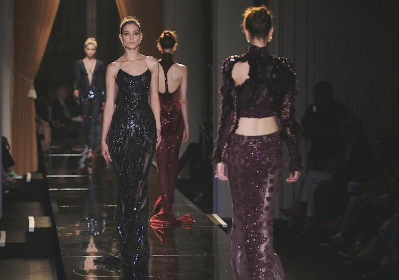 Models wear creations by fashion designer Donatella Versace during her Women's Fall Winter 2013 haute couture fashion collection in Paris, France, Sunday, June 30, 2013. (AP Photo/Jacques Brinon)