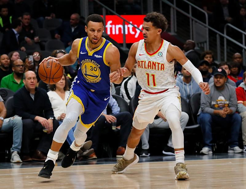 Trae Young probably isn't going to a better shooter than Stephen Curry in a year, and that's OK. (Photo by Kevin C. Cox/Getty Images)