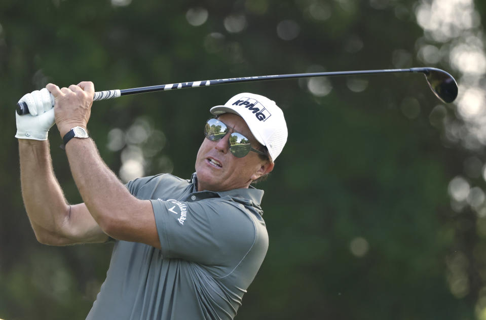 Phil Mickelson plays his shot from the 12th tee during the first round of the Charles Schwab Challenge golf tournament at the Colonial Country Club in Fort Worth, Texas, Thursday, May 27, 2021. (AP Photo/Ron Jenkins)