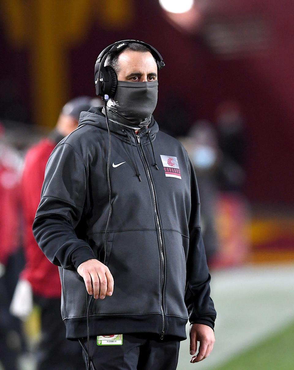 Washington State Cougars head coach Nick Rolovich looks on from the sidelines during a Dec. 6, 2020 game.