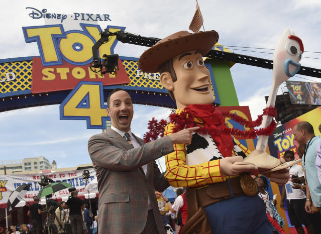 """Actor Tony Hale, from left, poses with characters Woody and Forky as he arrives at the world premiere of """"Toy Story 4"""" on Tuesday, June 11, 2019, at the El Capitan in Los Angeles. (Photo by Chris Pizzello/Invision/AP)"""