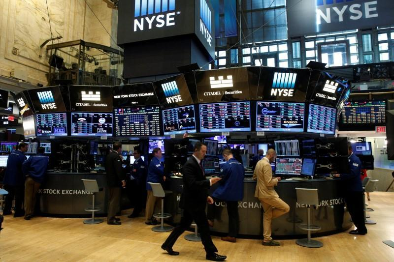 Traders work at the Citadel Securities post on the floor of the NYSE