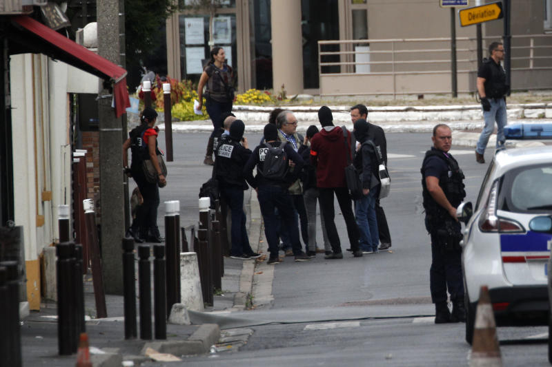 French police officers stand outside a building in Villejuif, south of Paris, Wednesday, Sept. 6, 2017 in Paris. The Paris prosecutor's office says two people have been detained after a possible explosives laboratory was discovered in a suburb south of Paris. (AP Photo/Christophe Ena)