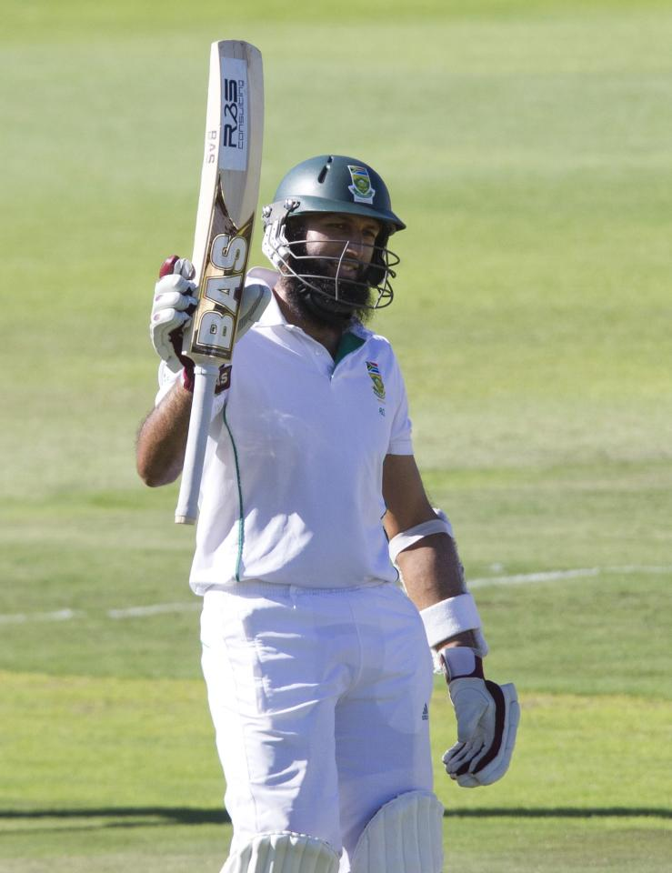 South Africa's Hashim Amla celebrates scoring a half century during the third day of the second cricket test match against Australia in Port Elizabeth, February 22, 2014. REUTERS/Rogan Ward (SOUTH AFRICA - Tags: SPORT CRICKET)