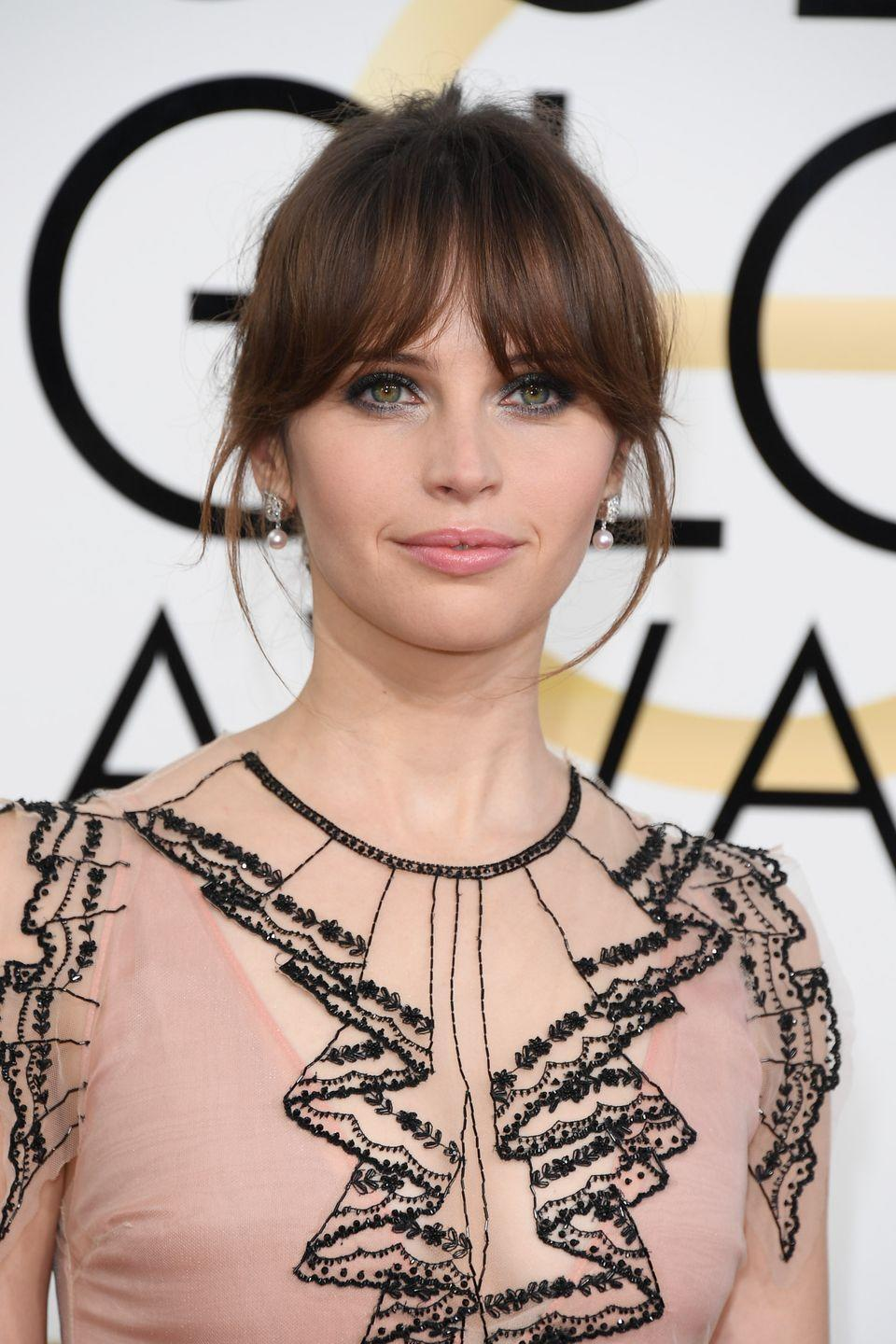 """<p>A set of smooth, blown-out bangs adds instant drama to a <a href=""""https://www.goodhousekeeping.com/beauty/hair/tips/g1800/celebrity-hairstyles-updo/"""" rel=""""nofollow noopener"""" target=""""_blank"""" data-ylk=""""slk:classic updo"""" class=""""link rapid-noclick-resp"""">classic updo</a>. If you aren't going for the regal look, pull out a few strands around the hairline for a wispy effect. </p>"""