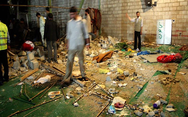 In 2008, Iranians inspect the site of an explosion inside a mosque in the southern city of Shiraz which killed 14 - STR/AFP