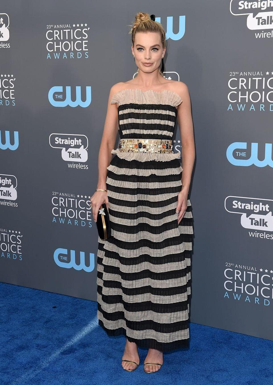 <p>The Wold of Wall Street actress wore a black and cream Chanel dress to the Critics Choice Awards </p>