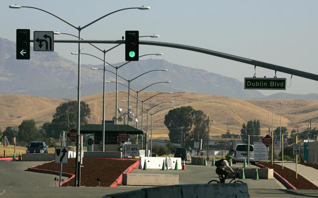 FILE - This July 20, 2006, file photo, shows the entrance to Camp Parks, which houses the Federal Correctional Institution in Dublin, Calif. A representative for Felicity Huffman Tuesday, Oct. 15, 2019, says the actress has reported to the federal prison in California to serve a two-week sentence in the college admissions scandal. (AP Photo/Ben Margot, File)