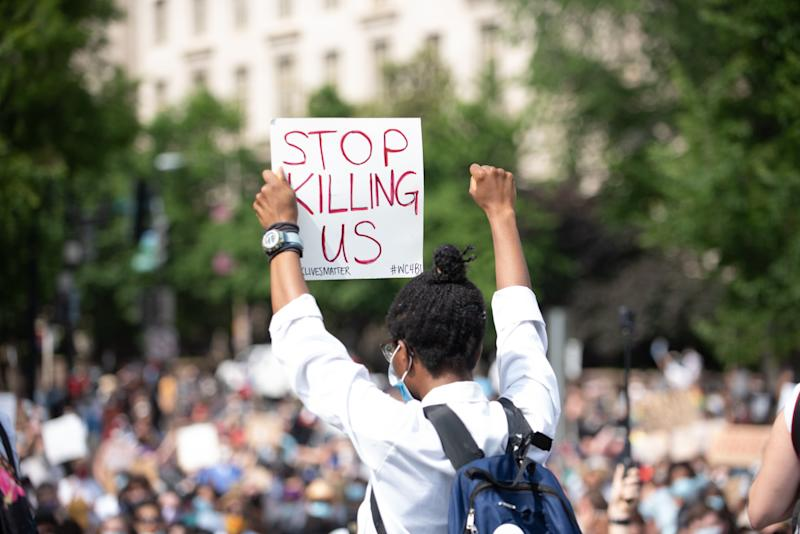 People take part in a demonstration in Washington, United Staets, on June 6, 2020 over the death of George Floyd, a black man who was in police custody in Minneapolis. Floyd died after being restrained by Minneapolis police officers. (Photo by Zach D Roberts/NurPhoto via Getty Images)