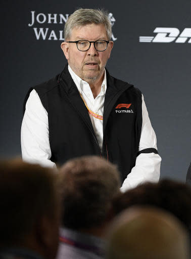 Ross Brawn, Formula One Managing Director of Motorsports, wears a black armband after the death of FIA Formula One Race Director Charlie Whiting, during a press conference at the Australian Grand Prix in Melbourne, Australia, Friday, March 15, 2019. The first race of the year is Sunday. (AP Photo/Andy Brownbill)
