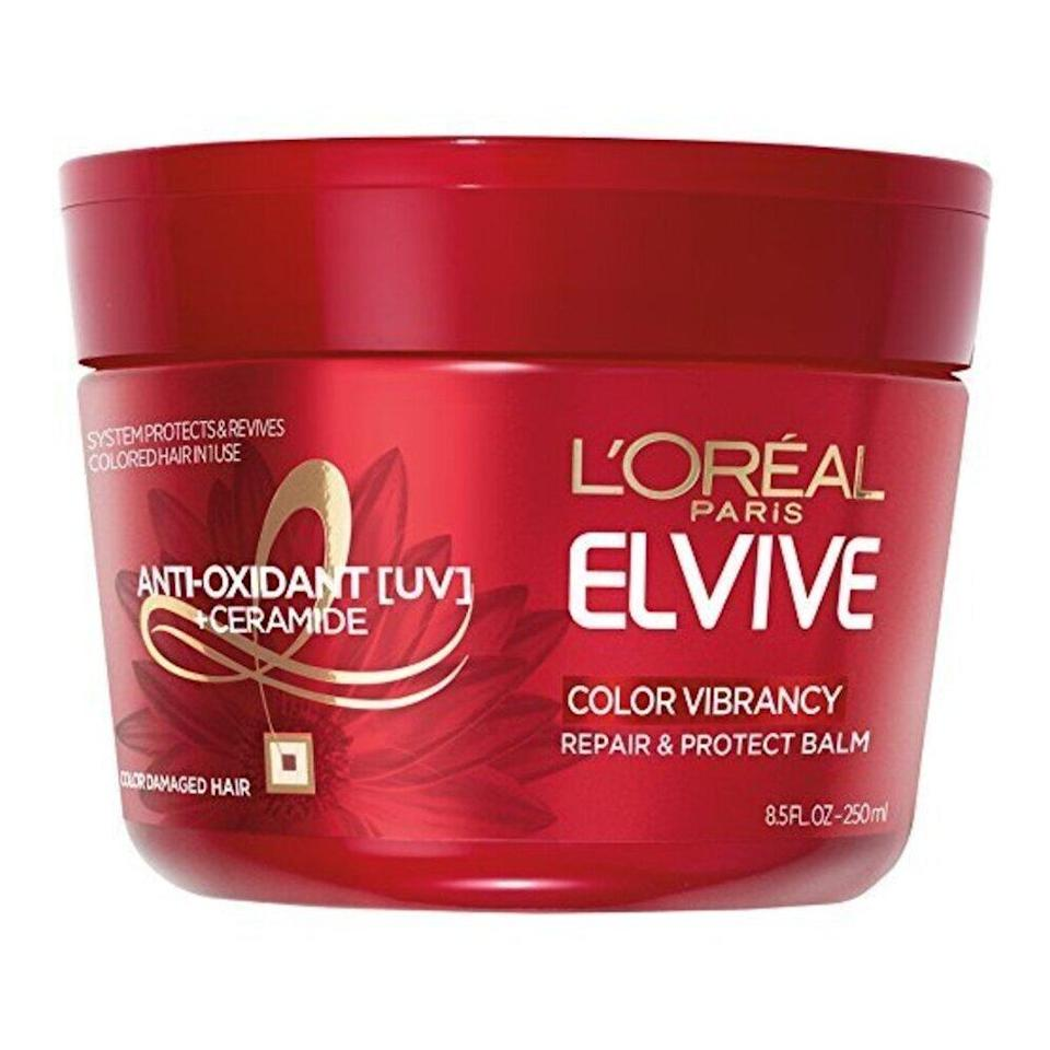 """Save yourself several trips to the salon: Instead, add the <a href=""""https://www.allure.com/review/loreal-total-repair-5-damage-erasing-balm?mbid=synd_yahoo_rss"""" rel=""""nofollow noopener"""" target=""""_blank"""" data-ylk=""""slk:Best of Beauty-winning Elvive Color Vibrancy Repair & Protect Balm"""" class=""""link rapid-noclick-resp"""">Best of Beauty-winning Elvive Color Vibrancy Repair & Protect Balm</a> from L'Oréal Paris to your <a href=""""https://www.allure.com/story/best-hair-care-tips-for-every-concern?mbid=synd_yahoo_rss"""" rel=""""nofollow noopener"""" target=""""_blank"""" data-ylk=""""slk:hair-care routine"""" class=""""link rapid-noclick-resp"""">hair-care routine</a>. The nourishing formula, which has antioxidant-rich niacinamide, helps preserve your hair color and prevents fading. Use it two times a week after shampooing for three to five minutes at a time."""