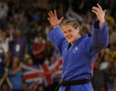 Britain's Karina Bryant celebrates after winning her women's 78kg bronze medal judo match against Ukraine's Iryna Kindzerska at the London 2012 Olympic Games August 3, 2012. REUTERS/Kim Kyung-Hoon (BRITAIN - Tags: SPORT JUDO SPORT OLYMPICS)
