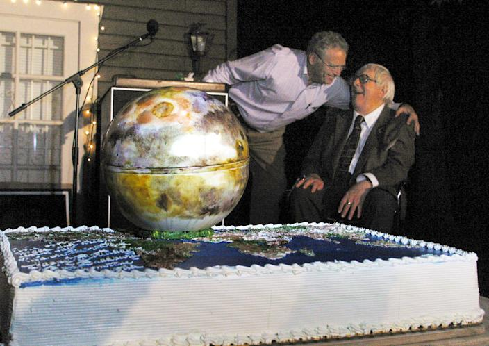 """Dr. Louis Friedman, left, executive director of The Planetary Society, presents author Ray Bradbury, with a Mars-shaped cake at Bradbury's 83rd birthday party held Saturday, Aug. 23, 2003, at the Planetary Society in Pasadena, Calif. Bradbury celebrated his 83rd birthday with this wish: One night, 100 years from now, a youngster will stay up late reading his 1950 classic """"The Martian Chronicles"""" with a flashlight under his blanket - on the Red Planet. (AP Photo/Stefano Paltera)"""