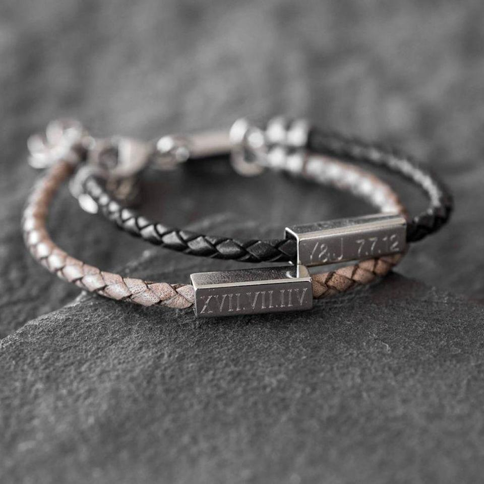 """<p><strong>Etsy</strong></p><p>etsy.com</p><p><strong>$34.30</strong></p><p><a href=""""https://go.redirectingat.com?id=74968X1596630&url=https%3A%2F%2Fwww.etsy.com%2Flisting%2F580260546%2Fmens-personalized-bracelet-mens-custom&sref=https%3A%2F%2Fwww.bestproducts.com%2Flifestyle%2Fg27420749%2Fengraved-gifts%2F"""" rel=""""nofollow noopener"""" target=""""_blank"""" data-ylk=""""slk:Shop Now"""" class=""""link rapid-noclick-resp"""">Shop Now</a></p><p>If he's not into shiny jewelry, but you're still in the market for something he can wear on his wrist, this leather bracelet with a stainless steel tube is a simple idea he'll love. You can engrave it with anything from names, dates, coordinates, and symbols.</p>"""