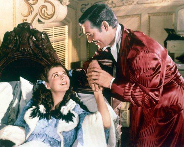 Clark Gable as Rhett Butler and Vivien Leigh as Scarlett O'Hara in Gone With The Wind, 1939. (Credit: Silver Screen Collection/Hulton Archive/Getty Images)