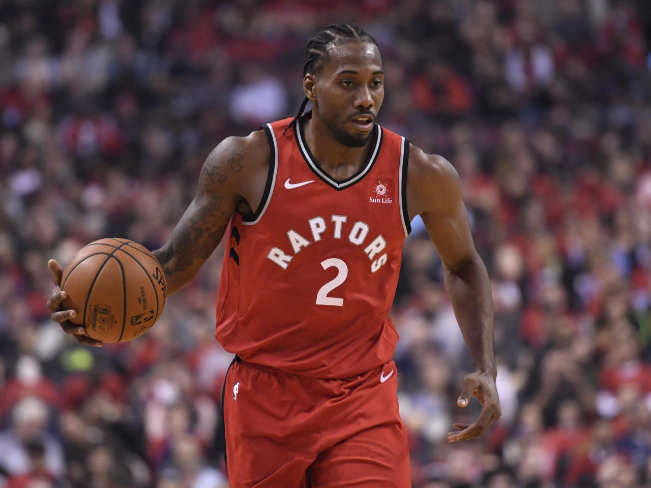 Toronto Raptors forward Kawhi Leonard (2) takes the ball up court against the Cleveland Cavaliers during first half NBA basketball action in Toronto on Wednesday, Oct. 17, 2018. (Nathan Denette/The Canadian Press via AP)