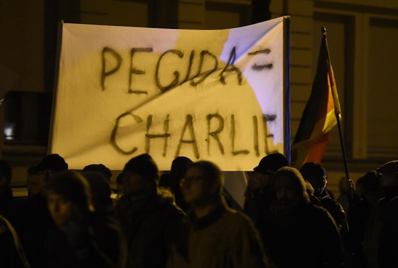 A poster reading 'PEGIDA=Charlie' during a rally of LEGIDA, a local copycat of Dresden's right-wing populist movement PEGIDA (Patriotic Europeans Against the Islamisation of the Occident), in Leipzig, eastern Germany on January 12, 2015 (AFP Photo/Odd Andersen)