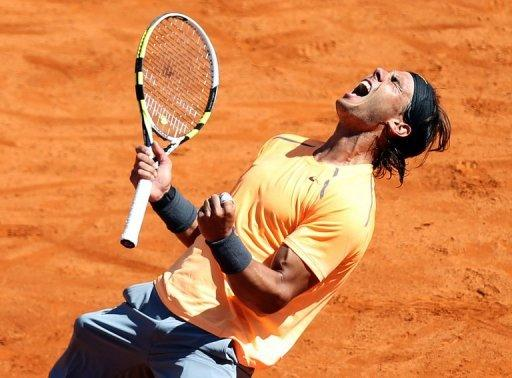 Spain's Rafael Nadal celebrates after winning against Serbia's Novak Djokovic