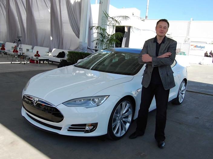 Elon Musk stands next to a Tesla Model S outside the Tesla plant in Fremont, CA, in 2011.