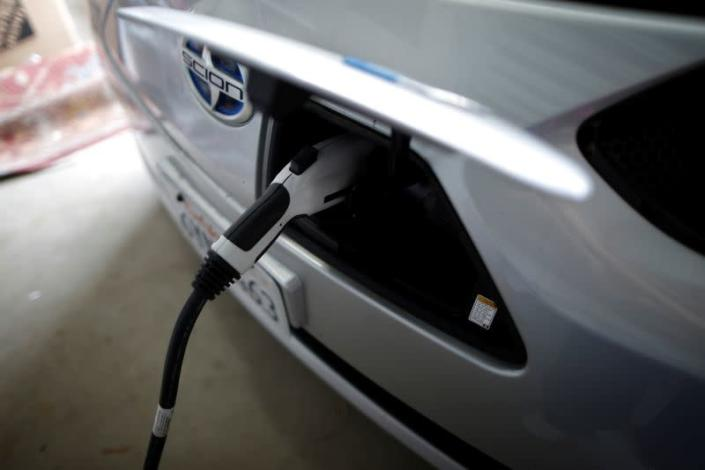 FILE PHOTO: A computer science professor's electric car is plugged in in her garage in Irvine, California