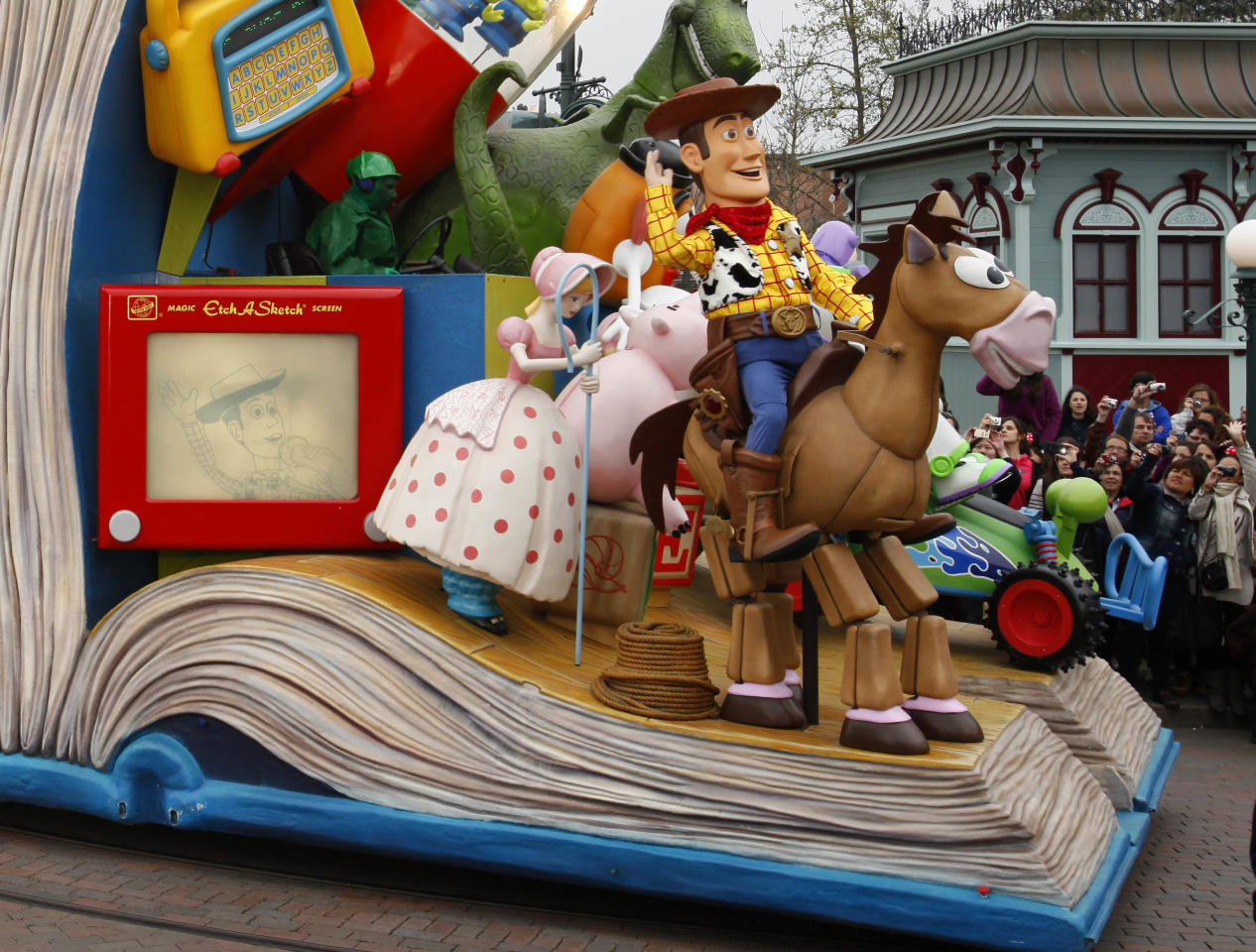 Characters from Euro Disneyland perform in Disneylands theme park in Marne-la-Vallee, east of Paris, Saturday March 31, 2012. This will mark the 20th year since Disneyland opened in Paris in 1992.(AP Photo/Michel Spingler)