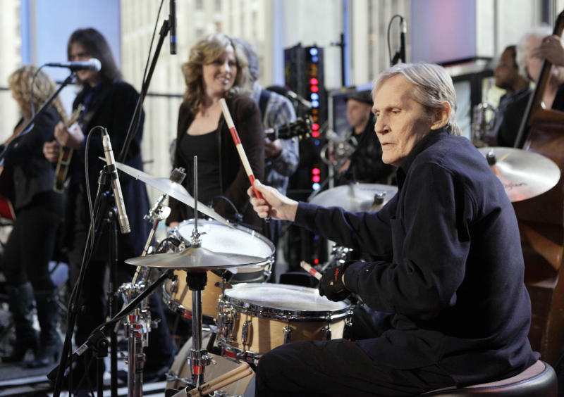 "FILE - In this Oct. 9, 2009 file photo, Levon Helm, right, performs with his band on the ""Imus in the Morning"" program on the Fox Business channel, in New York. At center is his daughter Amy Helm. Helm, who was in the final stages of his battle with cancer, died Thursday, April 19, 2012 in New York.  He was 71.  He was a key member of The Band and lent his distinctive Southern voice to classics like ""The Weight"" and ""The Night They Drove Old Dixie Down."" (AP Photo/Richard Drew, file)"