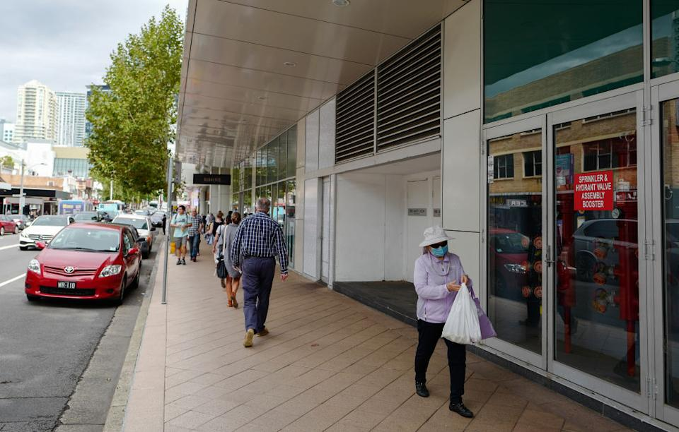 People out in the suburb of Chatswood during the middle of the morning.