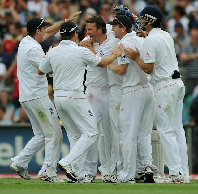 England's Graeme Swann (C) is congratulated by teammates after taking the wicket of Australia's Usman Khawaja on day one of the fifth Ashes cricket Test at the Sydney Cricket Ground on January 3, 2011. Khawaja was out for 37 runs. TOPSHOTS IMAGE STRICTLY RESTRICTED TO EDITORIAL USE - STRICTLY NO COMMERCIAL USE AFP PHOTO / Greg WOOD (Photo credit should read GREG WOOD/AFP/Getty Images)