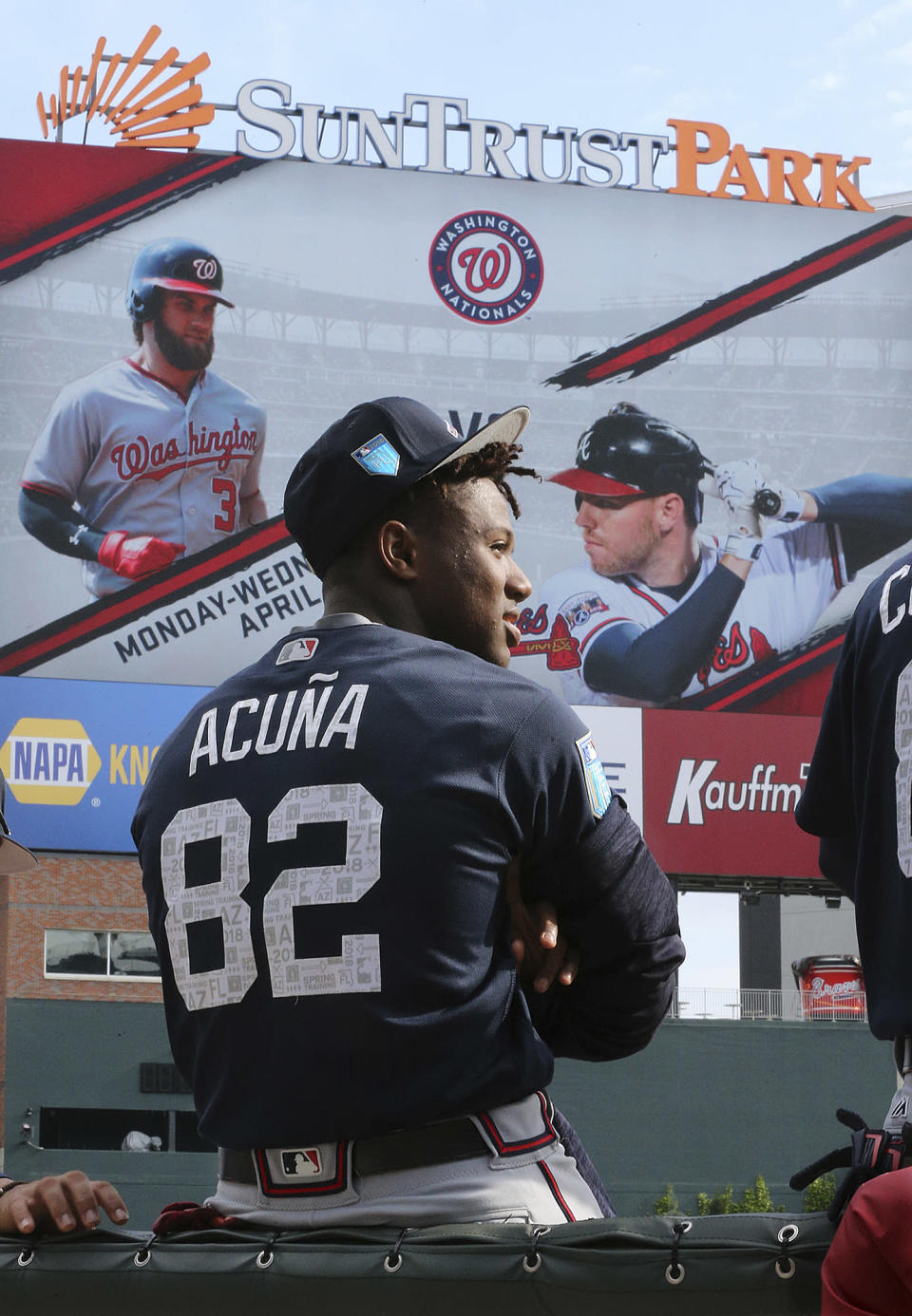 """Atlanta Braves prospect Ronald Acuna Jr., takes in the scene as he prepares to play for the """"Future Stars"""" team in an exhibition baseball game against the Atlanta Braves on Tuesday, March 27, 2018, in Atlanta. (Curtis Compton/Atlanta Journal-Constitution via AP)"""