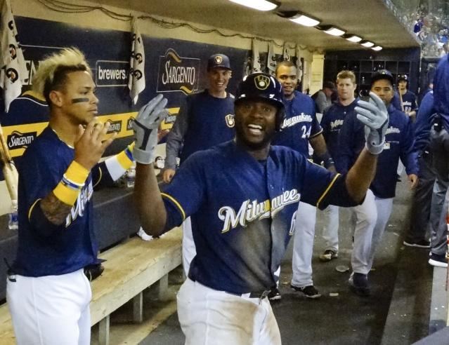 Milwaukee Brewers' Lorenzo Cain celebrates after hitting a home run during the fifth inning of a baseball game against the Miami Marlins Thursday, April 19, 2018, in Milwaukee. (AP Photo/Morry Gash)