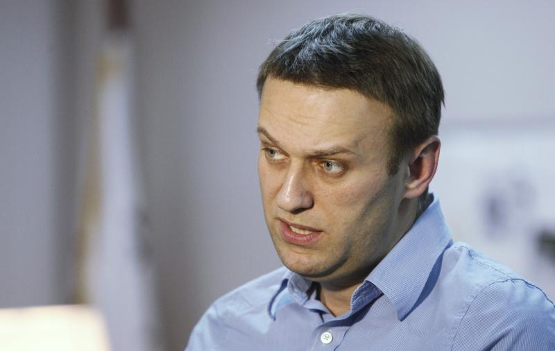 Anti-corruption campaigner Alexei Navalny speaks during an interview with Reuters in Moscow