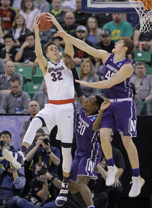 <p>Northwestern's Gavin Skelly (44) and Scottie Lindsey (20) defend against Gonzaga forward Zach Collins (32) during the first half of a second-round college basketball game in the men's NCAA Tournament, Saturday, March 18, 2017, in Salt Lake City. (AP Photo/Rick Bowmer) </p>