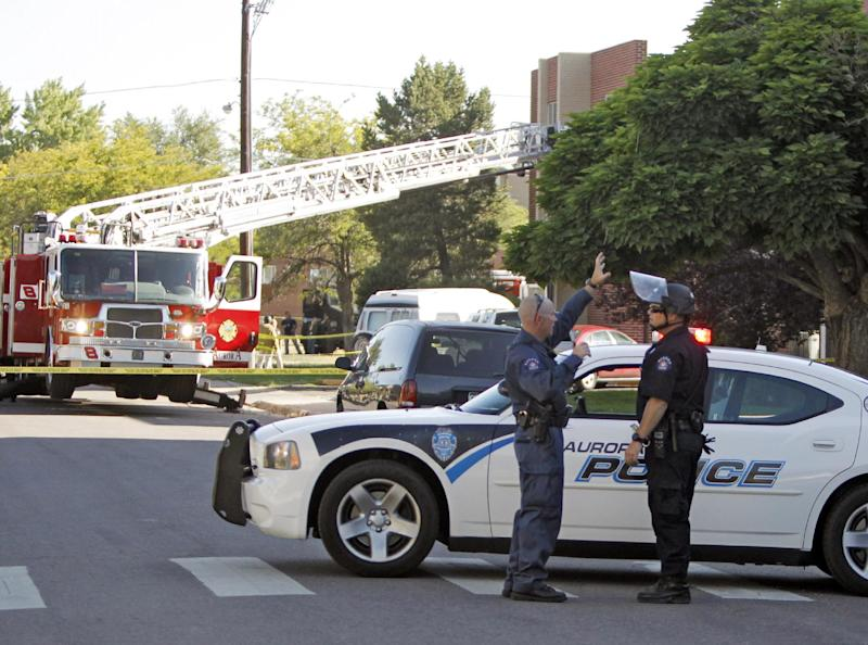 Police block the road in front of  an apartment where the suspect in a theatre shooting lived in Aurora, Colo., on Friday, July 20, 2012. As many as 12 people were killed and 50 injured at a shooting at the Century 16 movie theatre on Friday. The suspect is identified as 24-year-old James Holmes.  (AP Photo/Ed Andrieski)